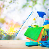 Colourfull cleaning supplies on the flowers background